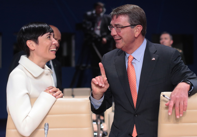 U.S. Defense Secretary Ash Carter talks with his counterpart from Norway, Ine Marie Eriksen Soreide, prior to a working session of the NATO-Ukraine Commission at  the NATO summit in Warsaw, Poland ...