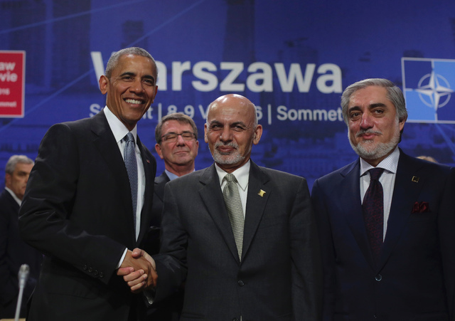 President Barack Obama shakes hands with Afghan President Ashraf Ghani, next to Afghanistan's Chief Executive Dr. Abdullah Abdullah, right, at the NATO summit in Warsaw, Poland, Saturday, July 9,  ...