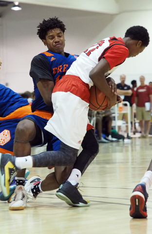Team Vision's Christian Popoola, Jr., (10) tries to grab the ball from Team Lillard's Tre Gray (22) at the Adidas Summer Championships basketball tournament in Las Vegas, Thursday, July 21, 2016.  ...