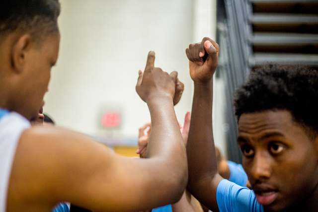 Team members of 702 Attack put their fists together before returning to the Fab 48 AAU tournament Thrusday, July 21, 2016 at Sierra Vista High School, Las Vegas. (Elizabeth Brumley/Las Vegas Revie ...