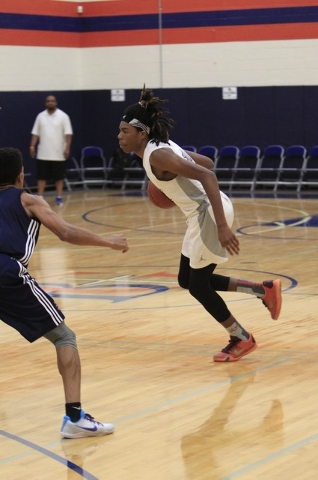 Greenwood Eliteճ Terry Armstrong (1) drives the ball against Costal Elite during the Las Vegas Fab Forty 8 U17 Invitational championship games on the final day of the AAU tournaments. (Richard Br ...
