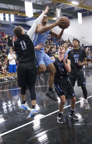 Team Howard Pulley shooting guard Gary Trent Jr., center, (1) goes up for shot against team UBC during the Las Vegas Classic AAU game at Spring Valley High School on Friday, July 22, 2016. (Richar ...