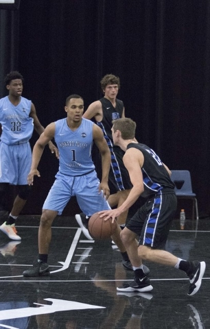 Team Howard Pulley shooting guard Gary Trent Jr., second left, (1) guards a team UBC player during the Las Vegas Classic AAU game at Spring Valley High School on Friday, July 22, 2016. (Richard Br ...