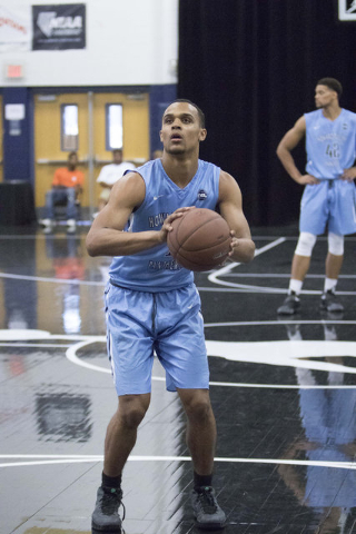 Team Howard Pulley shooting guard Gary Trent Jr., left, (1) prepares for a free throw shot against team UBC during the Las Vegas Classic AAU game at Spring Valley High School on Friday, July 22, 2 ...
