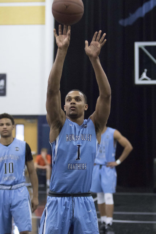 Team Howard Pulley shooting guard Gary Trent Jr. (1) shoots a free throw shot against team UBC during the Las Vegas Classic AAU game at Spring Valley High School on Friday, July 22, 2016. (Richard ...