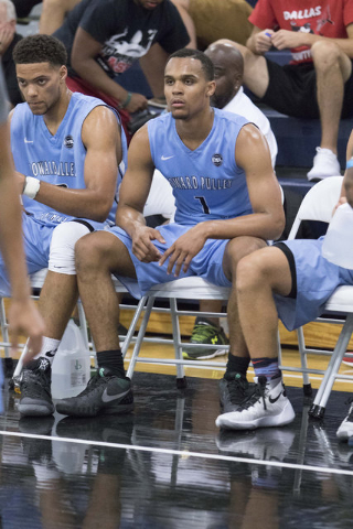 Team Howard Pulley shooting guard Gary Trent Jr., center, (1) is seen on the bench while playing against team UBC in the Las Vegas Classic AAU game at Spring Valley High School on Friday, July 22, ...