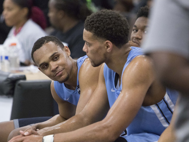 Team Howard Pulley shooting guard Gary Trent Jr., left, is seen on the bench while playing against team UBC in the Las Vegas Classic AAU game at Spring Valley High School on Friday, July 22, 2016. ...