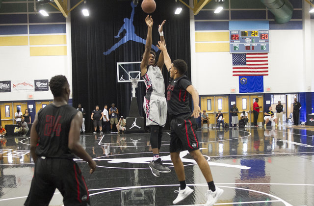 Team CP3 forward Wendell Carter, center, (35) shoots over a Mokan Elite player during the championship game of The 8 Bracket in the Las Vegas Classic at Spring Valley High School on Friday, July 2 ...