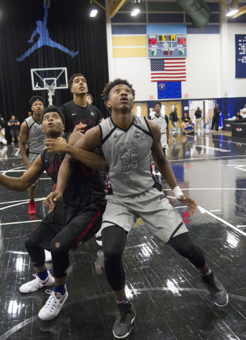 Team CP3 forward Wendell Carter, center, (35) looks for a rebound as he is pressured by a Mokan Elite player during the championship game of The 8 Bracket in the Las Vegas Classic at Spring Valley ...