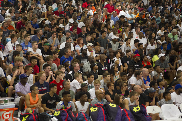 Spectators are seen in the bleachers during the team CP3 versus team Mokan Elite championship game of The 8 Bracket in the Las Vegas Classic at Spring Valley High School on Friday, July 22, 2016.  ...