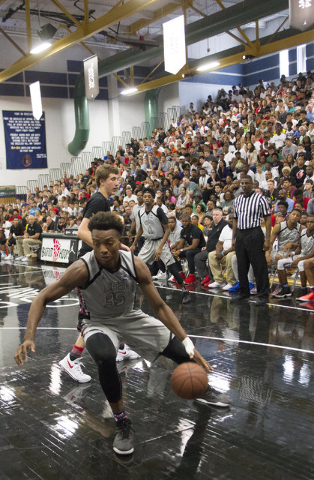 Team CP3 forward Wendell Carter (35) drives the ball against Mokan Elite players during the championship game of The 8 Bracket in the Las Vegas Classic at Spring Valley High School on Friday, July ...