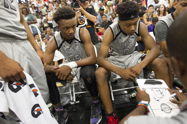Team CP3 forward Wendell Carter, second left, (35) listens to a coach during the championship game of The 8 Bracket against team Mokan Elite in the Las Vegas Classic at Spring Valley High School o ...