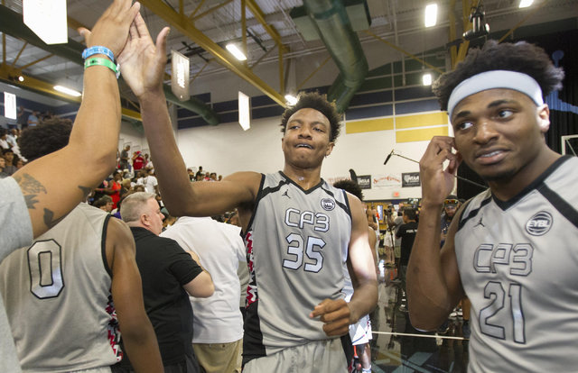 Team CP3 forward Wendell Carter high fives a member team Mokan Elite after winning the championship game of The 8 Bracket in the Las Vegas Classic at Spring Valley High School on Friday, July 22,  ...
