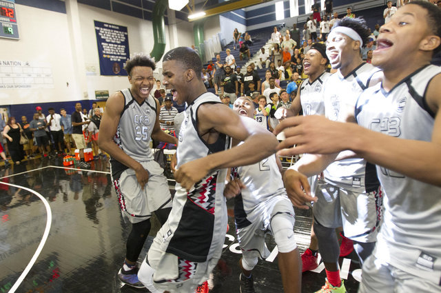 Team CP3 forward Wendell Carter, left, (35) celebrates with his team after defeating team Mokan Elite in the  championship game of The 8 Bracket in the Las Vegas Classic at Spring Valley High Scho ...