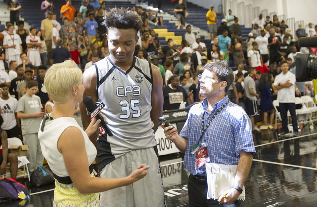 Team CP3 forward Wendell Carter, center, (35) is interviewed by reporters after defeating team Mokan Elite in the championship game of The 8 Bracket in the Las Vegas Classic at Spring Valley High  ...