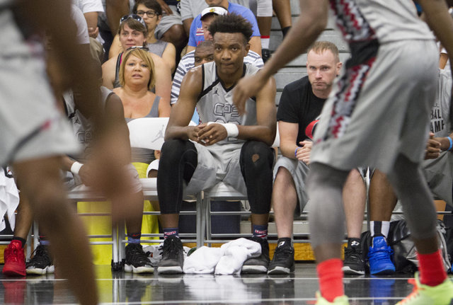 Team CP3 forward Wendell Carter, center, is seen on the bench against team Mokan Elite during the championship game of The 8 Bracket in the Las Vegas Classic at Spring Valley High School on Friday ...