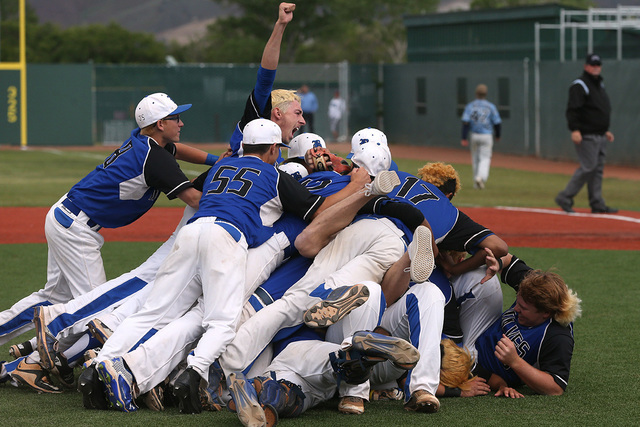 The Basic Wolves celebrate their 9-1 win over Centennial for the NIAA DI baseball championship at Bishop Manogue High School in Reno, Nev., on Saturday, May 21, 2016. (Cathleen Allison/Las Vegas R ...