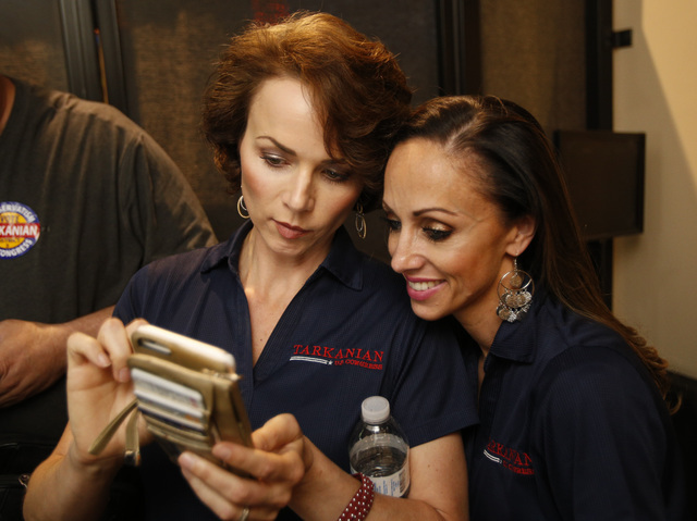 Amy Tarkanian, left, wife of Republican Congressional District 3 candidate Danny Tarkanian and her friend Jamie Brashaw check for campaign result updates during Tarkanian's election night gatherin ...