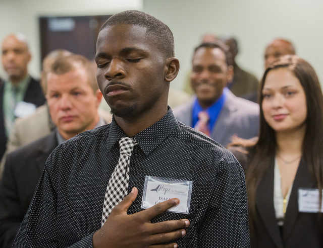 Ex-offender Alfred Jackson closes his eyes during the HOPE for Prisoners graduation ceremony Friday, July 22, 2016, at LVMPD Headquarters, 400 S Martin Luther King Blvd. Twenty-six people graduate ...