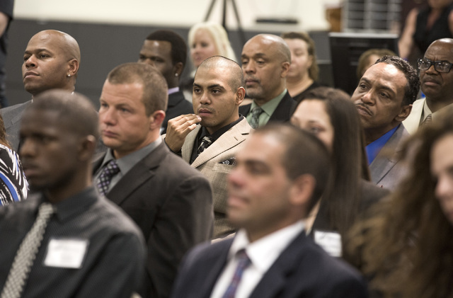 Ex-offenders listen during HOPE for Prisoners graduation ceremony Friday, July 22, 2016, at LVMPD Headquarters, 400 S Martin Luther King Blvd. Twenty-six people graduated in the reentry program. ( ...