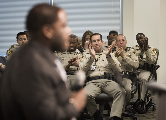 Las Vegas police officers applaud ex-offender Marcus Jacquette during the HOPE for Prisoners graduation ceremony Friday, July 22, 2016, at LVMPD Headquarters, 400 S Martin Luther King Blvd. Jacque ...