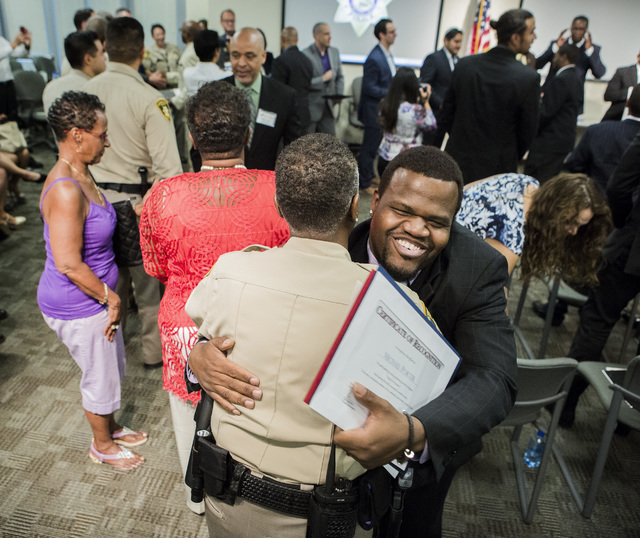 Ex-offender Michael Porter hugs Las Vegas police officer M. Drew during the HOPE for Prisoners graduation ceremony Friday, July 22, 2016, at LVMPD Headquarters, 400 S Martin Luther King Blvd. Twen ...