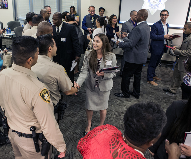 Ex-offender Kimberly Holmstrom shakes hands with Las Vegas police officers during the HOPE for Prisoners graduation ceremony Friday, July 22, 2016, at LVMPD Headquarters, 400 S Martin Luther King  ...