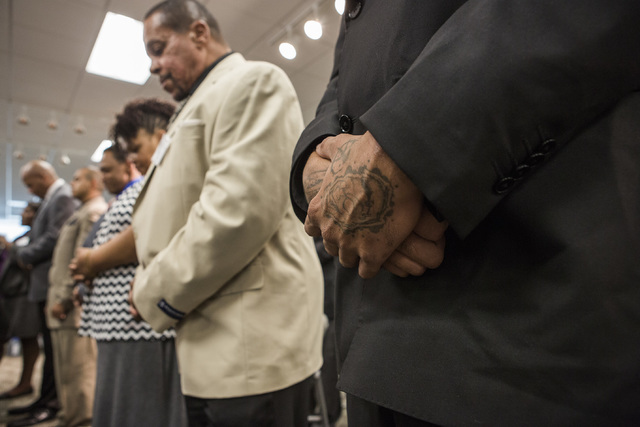 Ex-offenders pray during the HOPE for Prisoners graduation ceremony Friday, July 22, 2016, at LVMPD Headquarters, 400 S Martin Luther King Blvd. Twenty-six people graduated in the reentry program. ...