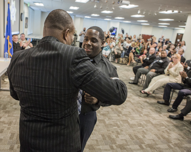 Jon Ponder, left, founder and CEO of HOPE for Prisoners  hugs ex-offender Marcus Jacquette during the HOPE for Prisoners graduation ceremony Friday, July 22, 2016, at LVMPD Headquarters, 400 S Mar ...