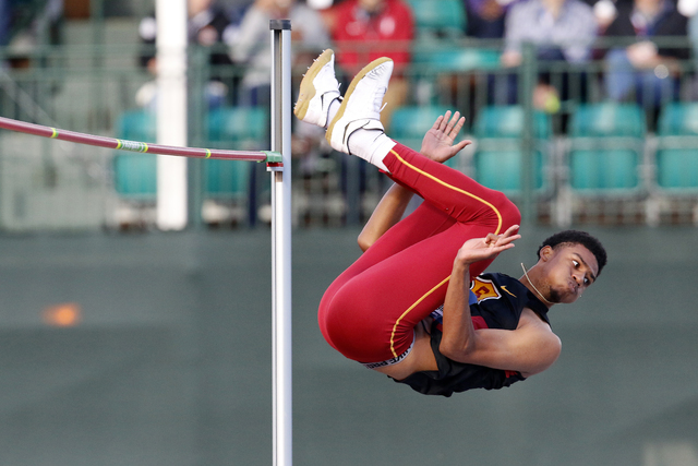 USC's Randall Cunningham clears the bar en route to winning the men's high jump at the NCAA outdoor track and field championships in Eugene, Ore., Friday, June 10, 2016. (AP Photo/Ryan Kang)