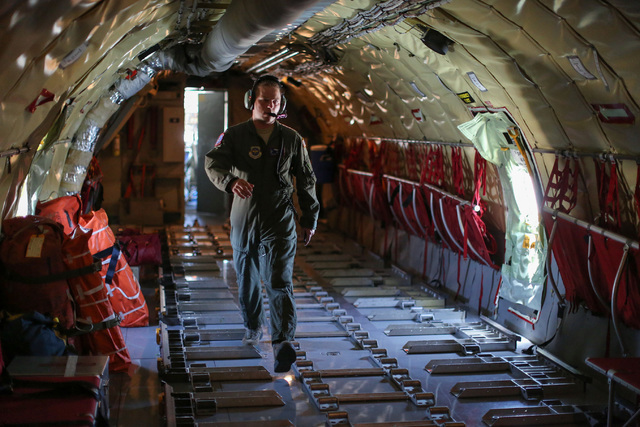 Capt. Tyler Todd, a KC-135 Stratotanker pilot in the 92nd Air Refueling Squadron, walks along the cargo hold of a Stratotanker on the flightline of Nellis Air Force Base during a Red Flag exercise ...