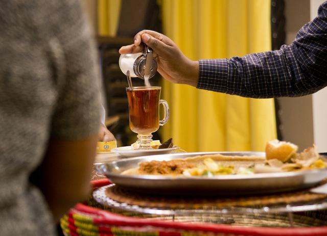 Shameles Mijo pours sugar into his tea at the Lucy Ethiopian Restaurant in Las Vegas on Wednesday, June 29, 2016. (Daniel Clark/Las Vegas Review-Journal Follow @DanJClarkPhoto)