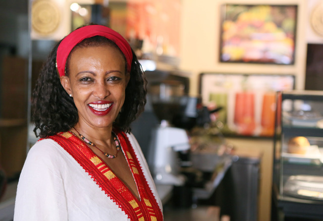 Owner Mulu Chokele wears a traditional Ethiopian dress at Kaldi's Coffee Friday, July 1, 2016, in Las Vegas. (Ronda Churchill/Las Vegas Review-Journal)