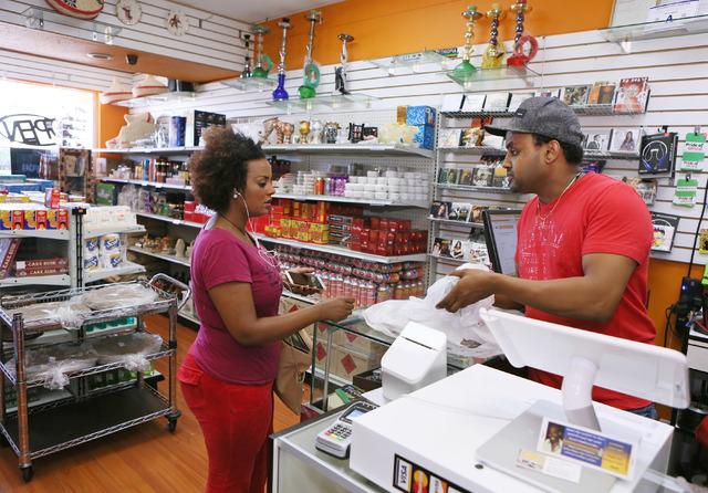 Tesfalem Solomon, right, rings up a purchase for customer Elsa Serekebirhan at Shola Market, 4001 S. Decatur Blvd. Suite 1, in Las Vegas, Friday, July 1, 2016. (Ronda Churchill/Las Vegas Review-Jo ...