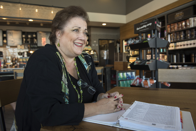 Julie Davies talks to a reporter during an interview regarding the city's licensing and zoning regulations on short-term residential rentals from a Starbucks on North Rancho Drive in Las Vegas, on ...