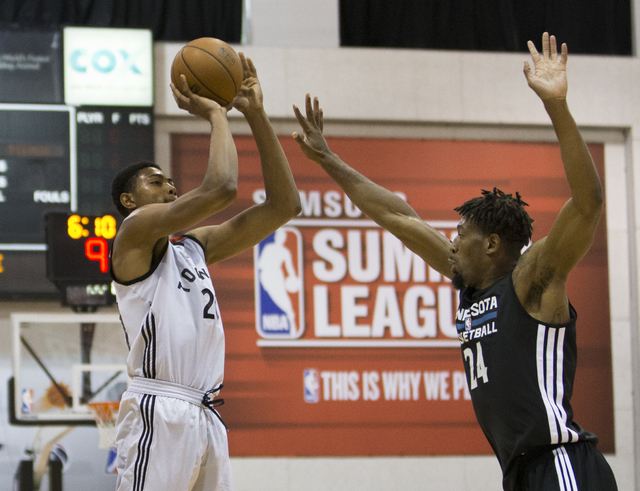 Toronto Raptors forward Bruno Caboclo (20) shoots over Minnesota Timberwolves forward Jarrid Famous (24) during the NBA Summer League tournament at Cox Pavilion at UNLV on Sunday, July 10, 2016, i ...