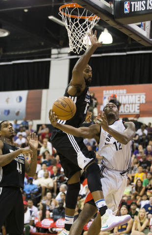 Toronto Raptors forward Jalen Jones (12) shoots over Minnesota Timberwolves center Keith Benson (13) during the NBA Summer League tournament at Cox Pavilion at UNLV on Sunday, July 10, 2016, in La ...