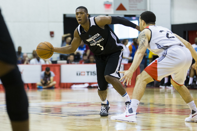 Minnesota Timberwolves guard Kris Dunn (3) passes around Toronto Raptors guard Fred VanVlett (23) during the NBA Summer League tournament at Cox Pavilion at UNLV on Sunday, July 10, 2016, in Las V ...