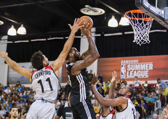 Minnesota Timberwolves center Keith Benson (13) shoots over Toronto Raptors guard Drew Crawford (11) during the NBA Summer League tournament at Cox Pavilion at UNLV on Sunday, July 10, 2016, in La ...