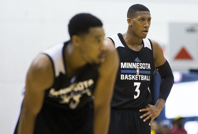 Minnesota Timberwolves guard Kris Dunn (3) watches a free throw attempt during the NBA Summer League tournament at Cox Pavilion at UNLV on Sunday, July 10, 2016, in Las Vegas. (Benjamin Hager/Las  ...