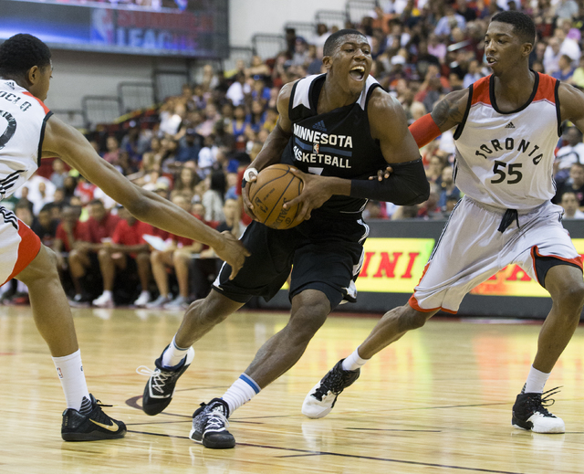 Minnesota Timberwolves guard Kris Dunn (3) drives past Toronto Raptors guard Delon Wright (55) during the NBA Summer League tournament at Cox Pavilion at UNLV on Sunday, July 10, 2016, in Las Vega ...