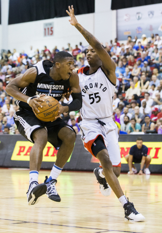 Minnesota Timberwolves guard Kris Dunn (3) jump steps around Toronto Raptors guard Delon Wright (55) during the NBA Summer League tournament at Cox Pavilion at UNLV on Sunday, July 10, 2016, in La ...