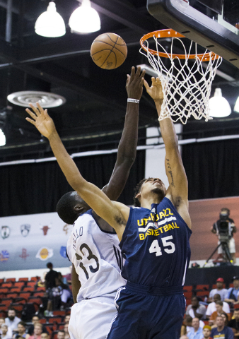 Utah Jazz forward Shonn Miller (45) fights for a rebound with New Orleans Pelicans forward Cheick Diallo (13) during the NBA Summer League tournament at Cox Pavilion at UNLV on Sunday, July 10, 20 ...