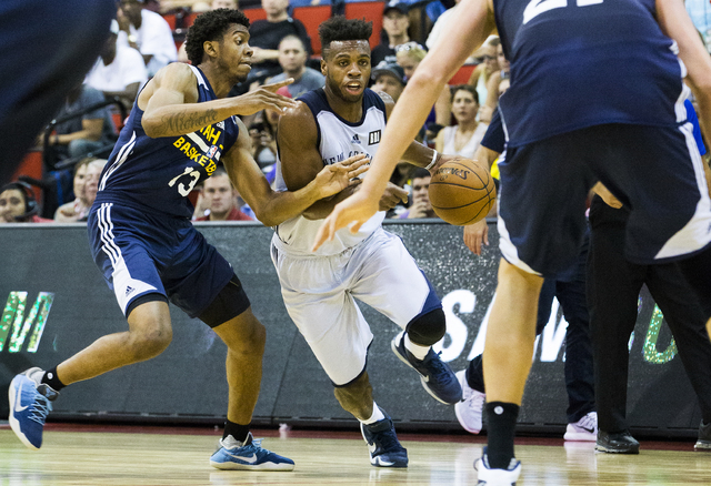 New Orleans Pelicans guard Buddy Hield (24) drives past Utah Jazz guard Tyrone Wallace (13) during the NBA Summer League tournament at Cox Pavilion at UNLV on Sunday, July 10, 2016, in Las Vegas.  ...