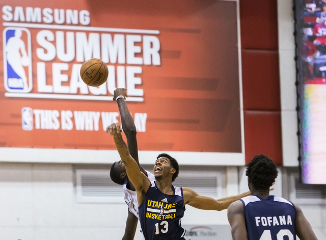 Utah Jazz guard Tyrone Wallace (13) wins a jump ball over New Orleans Pelicans forward Cheick Diallo (13) during the NBA Summer League tournament at Cox Pavilion at UNLV on Sunday, July 10, 2016,  ...