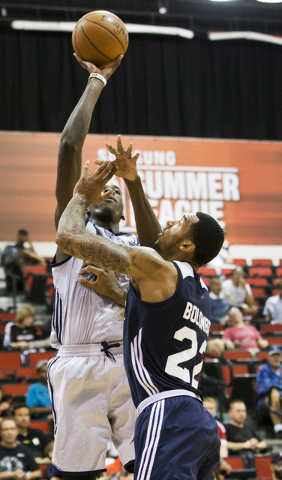 New Orleans Pelicans forward Cheick Diallo (13) shoots over Utah Jazz center Joel Bolomboy (22) during the NBA Summer League tournament at Cox Pavilion at UNLV on Sunday, July 10, 2016, in Las Veg ...