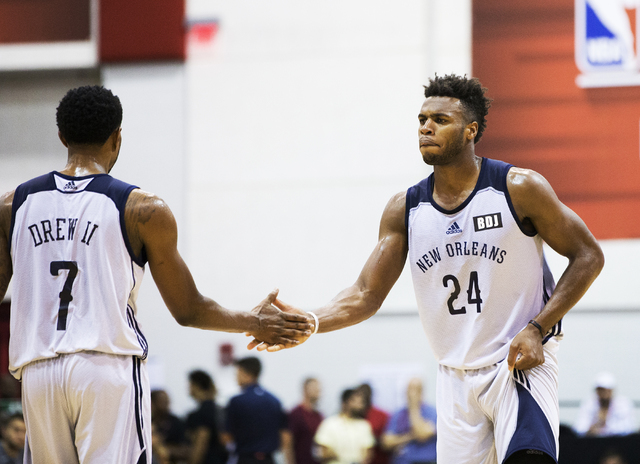 New Orleans Pelicans guard Buddy Hield (24) high fives teammate Larry Drew II (7) during the NBA Summer League tournament at Cox Pavilion at UNLV on Sunday, July 10, 2016, in Las Vegas. (Benjamin  ...