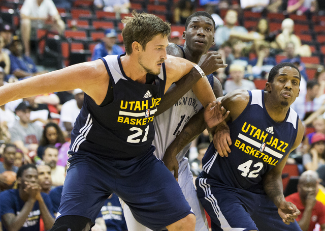 Utah Jazz center Tibor Pleiss (21) and Shaquille McKissic (42) box out New Orleans Pelicans forward Cheick Diallo (13) during the NBA Summer League tournament at Cox Pavilion at UNLV on Sunday, Ju ...
