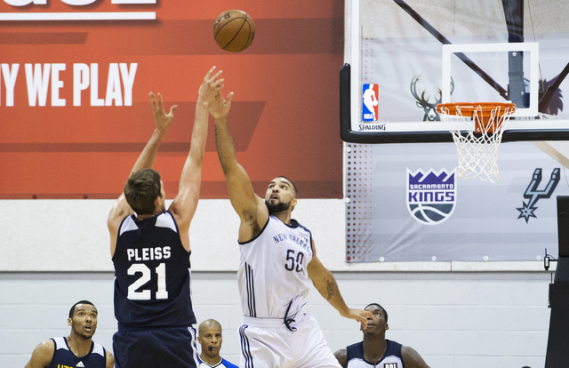 New Orleans Pelicans center Liam McMorrow (50) extends to block the shot of Utah Jazz center Tibor Pleiss (21) during the NBA Summer League tournament at Cox Pavilion at UNLV on Sunday, July 10, 2 ...