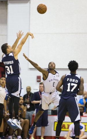 Utah Jazz guard Spencer Butterfield (31) shoot a contested jump shot over New Orleans Pelicans guard Anthony Barber (0) during the NBA Summer League tournament at Cox Pavilion at UNLV on Sunday, J ...